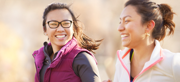 Young women running together